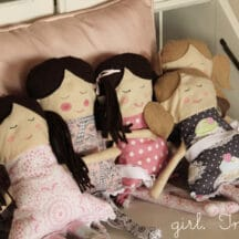 fabric dolls lined up sitting