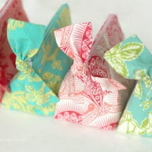 four zippered pouches lined up with bows