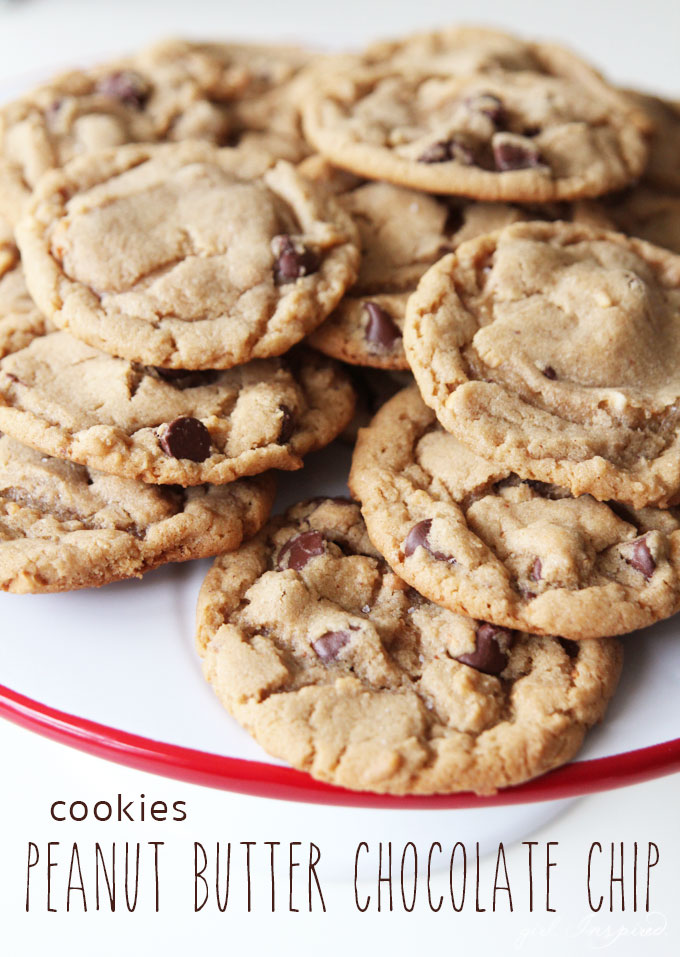 pile of peanut butter chocolate chip cookies on white cake stand with red rim and text overlay