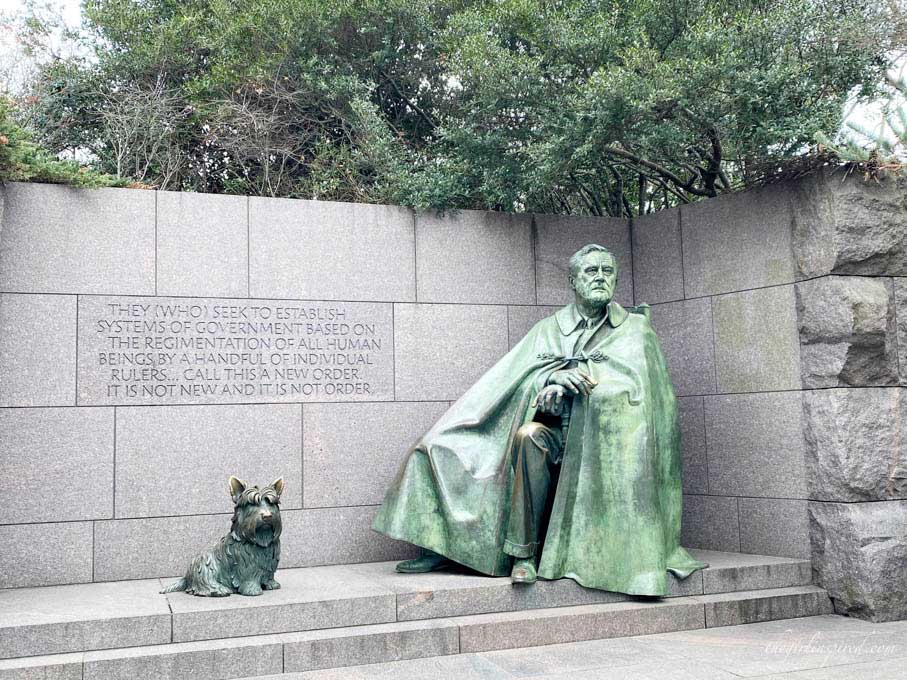 large iron sculpture of Franklin Roosevelt and his dog on stone steps