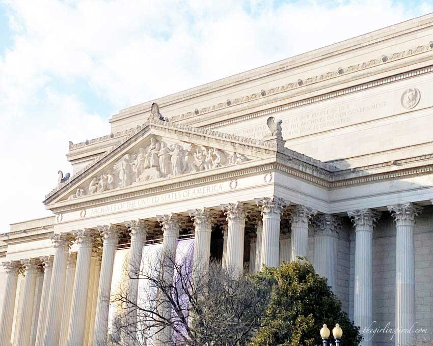 street view of museum of archives in Washington, large white concrete building with pillars and engravings.