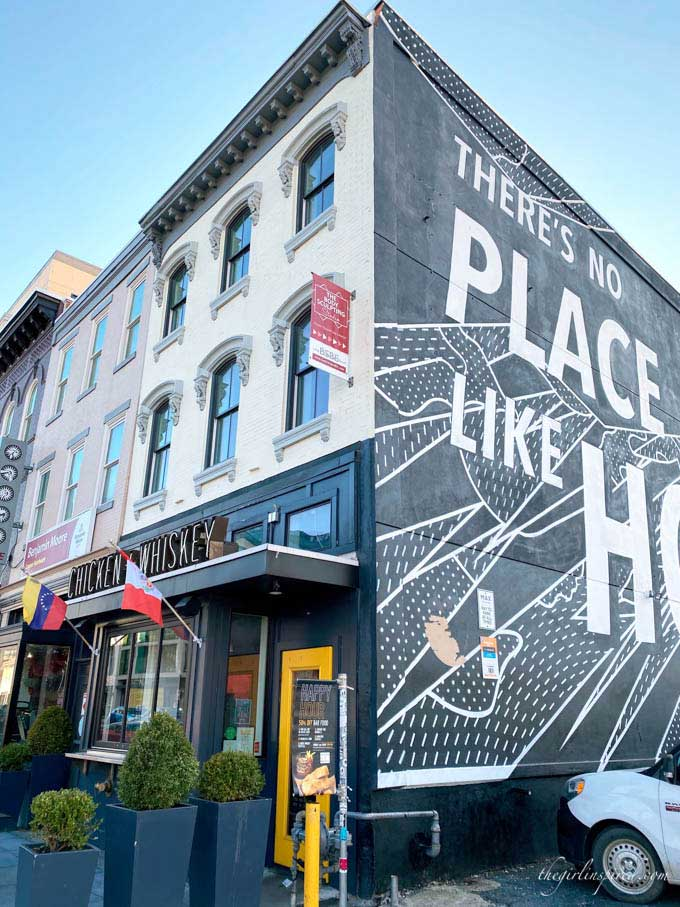 street view of restaurant in DC with flags and text graffiti art