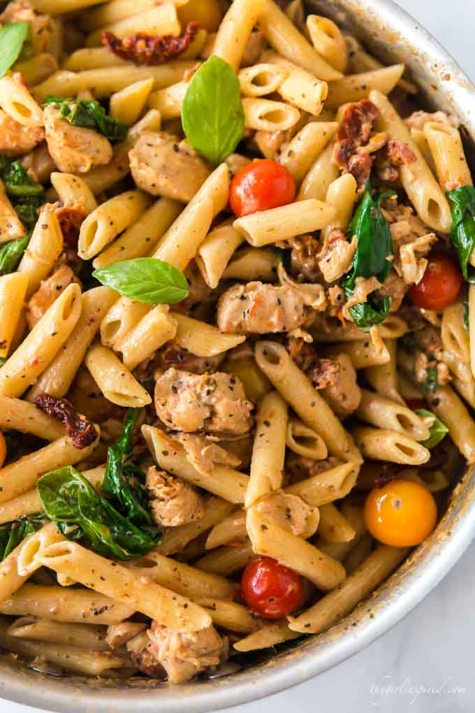 penne pasta with sun-dried tomatoes, chicken, and spinach