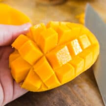 half of a mango inverted so that chunks are popped outward