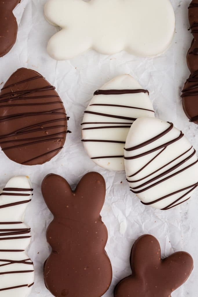 white and milk chocolate bunny and egg shapes with dark chocolate drizzle over the top