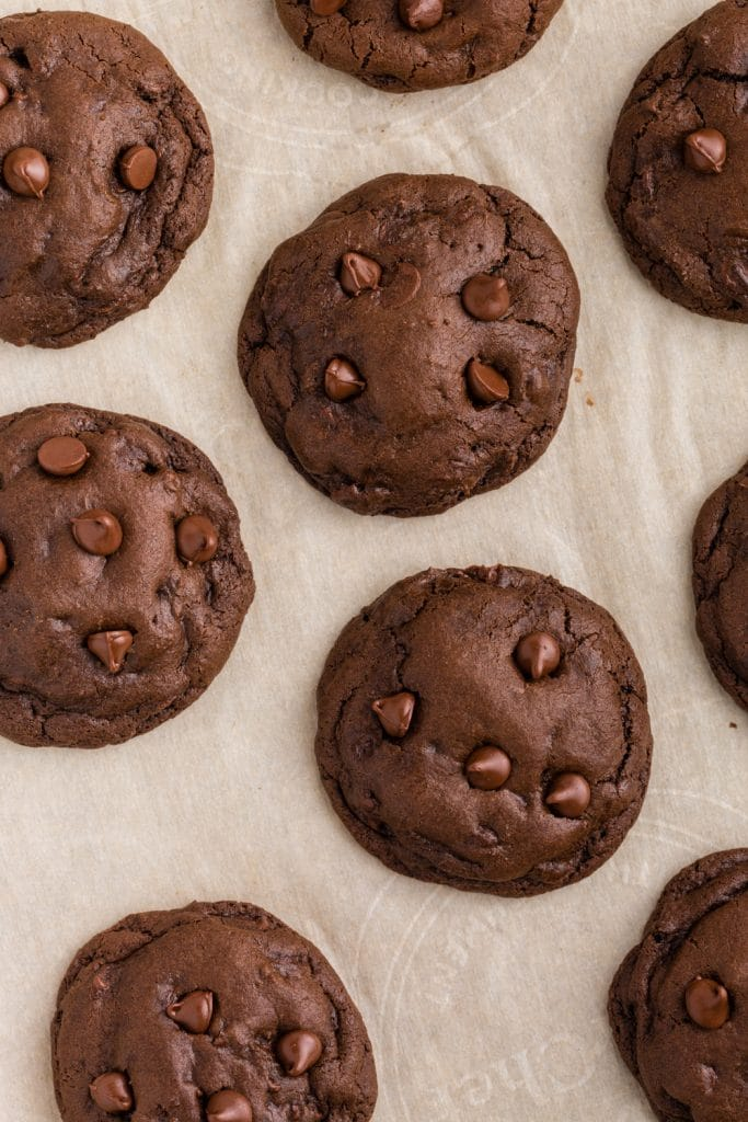 overhead photo of double chocolate chip cookies on parchment paper