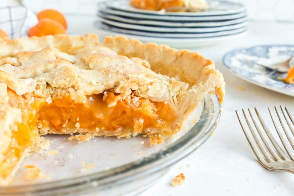 side view of apricot pie in glass pie plate