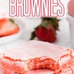 front view of stacked strawberry brownies with bite taken out with text overlay