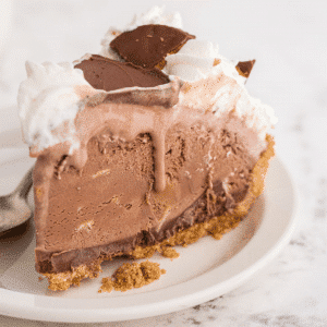 a slice of peanut butter chocolate ice cream pie on a white cake plate