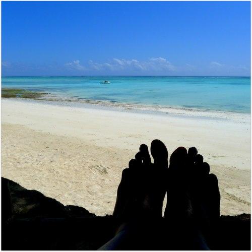 Feet at Beach Solo Female Travel Zanzibar Tanzania | The Girl Next Door is Black
