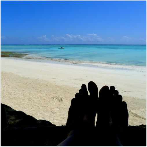 Feet at Beach Solo Female Travel Zanzibar Tanzania | The Girl Next Door is Black