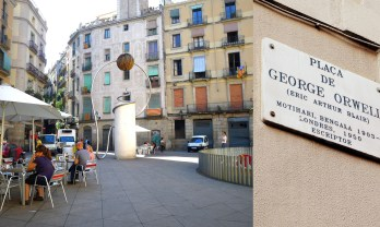 """George Orwell plaza in the Gothic district. Interestingly, this was one of the first public spaces in Barcelona to have video surveillance installed. It also used to be known as """"Plaza Trippy"""" because of the drug deals, drug use and other assorted underground activities took place there."""