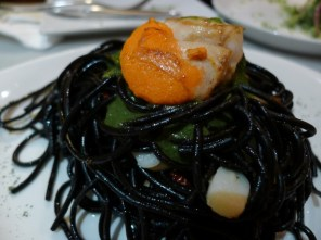 Squid ink spaghetti with garlic, pesto and grilled scallops.