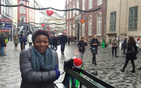 Standing in rainy Copenhagen  | The Girl Next Door is Black