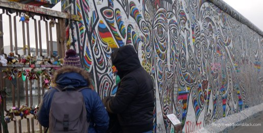 Couple at Love padlocks Berlin Wall