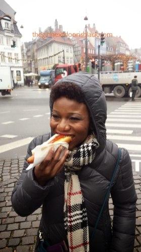 Eating a hot dog from Pølsevogn Copenhagen, Denmark | The Girl Next Door is Black