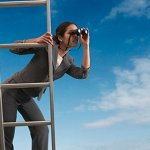 Woman-on-a-ladder-searching