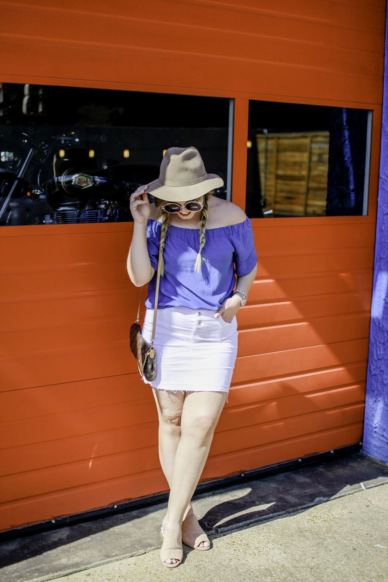 The Glitter Gospel Blog sharing summer outfit inspiration. Barista Parlor, East Nashville, Off Shoulder Top, White denim mini skirt, Nude Mules, Tan Fedora, Neck Scarf, 70's inspired outfit