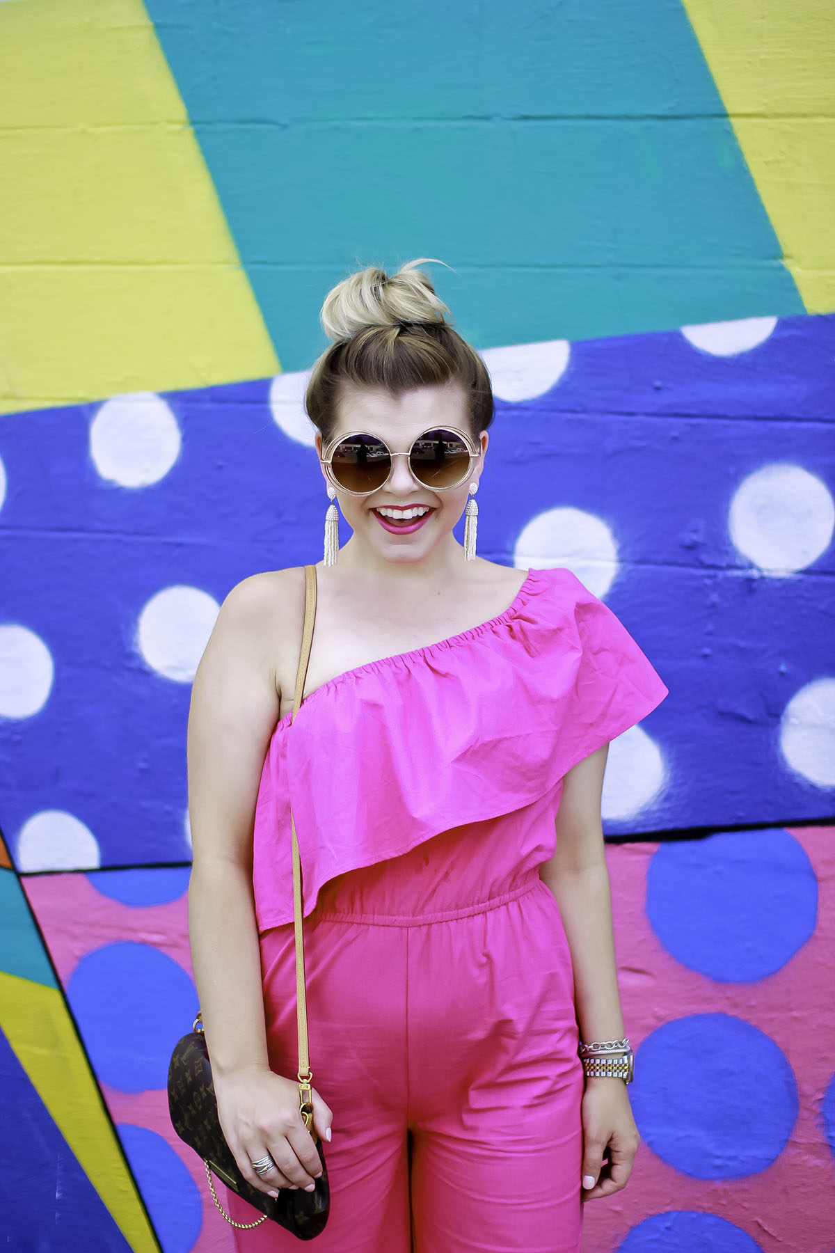 The Glitter Gospel Blog. Summer outfit inspiration with an Asos One Shoulder Jumpsuit in Pink. Colorful Outfit, Colorful Murals, Nashville Murals, The Gulch Nashville, Round Sunglasses, Baublebar Earrings, Jeffrey Campbell Pearl Slides