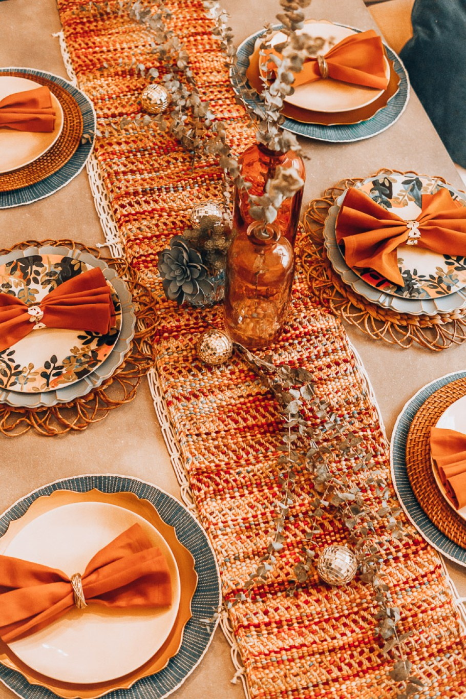 The Glitter Gospel Blog sharing tips for boho Thanksgiving decor for the upcoming holiday. Thanksgiving tablescape, casual Thanksgiving outfit, Pier One Decor, Wayfair, Farmhouse concrete top table, restoration hardware gold chairs, sofa as dining seating.