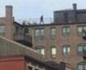 Who is this person? Individual seen walking on roof directly overhead as bomb goes off at Boston Marathon