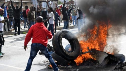 South African burning tires in protests that led to xenophobic violence
