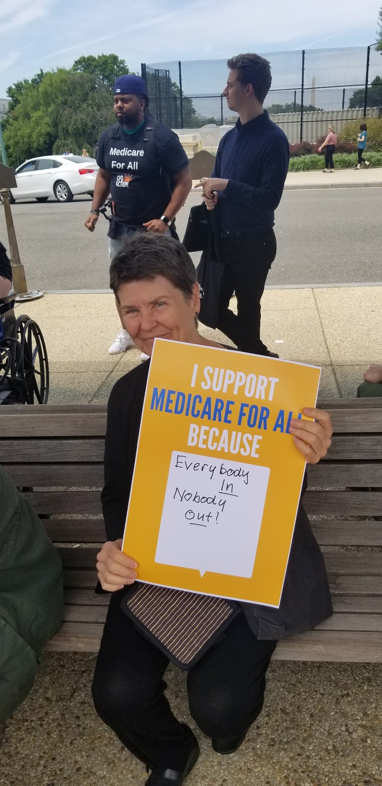 Medicare for All supporter with a sign
