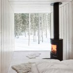 wood-burner-in-wing-of-four-cornered-villa-by-ville-hara-819x1024.jpg