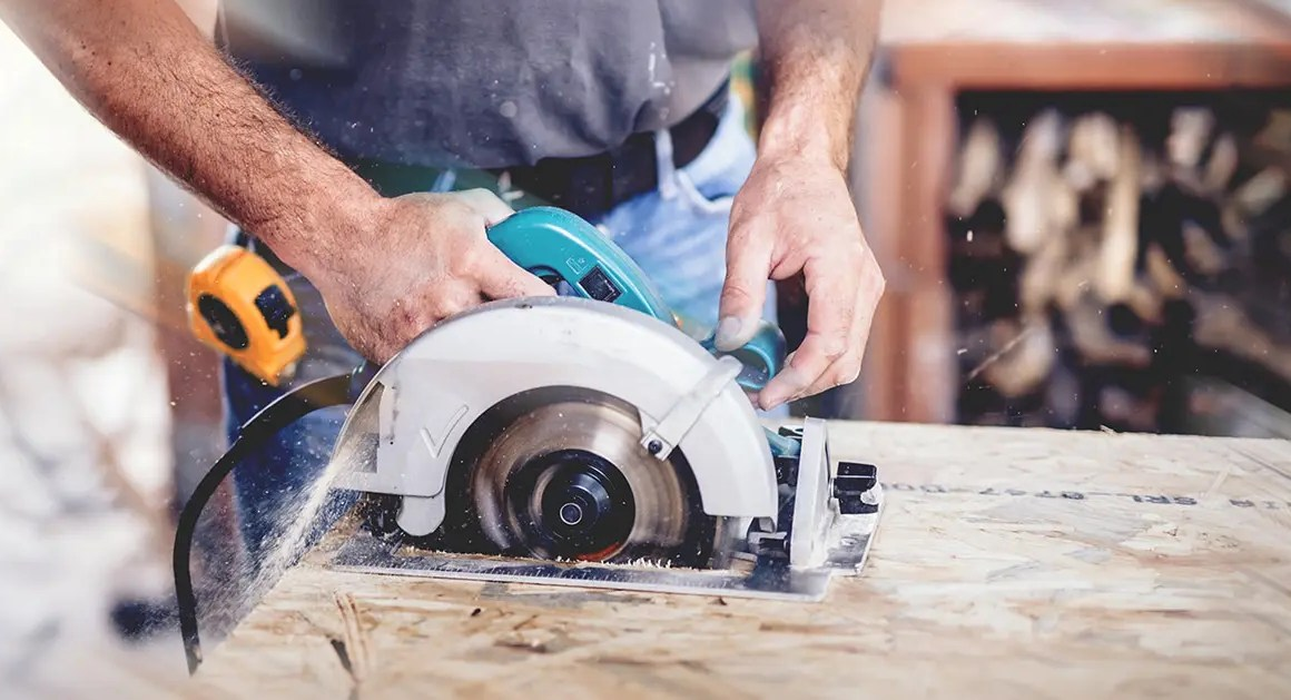 Man operating power tool without protective gloves