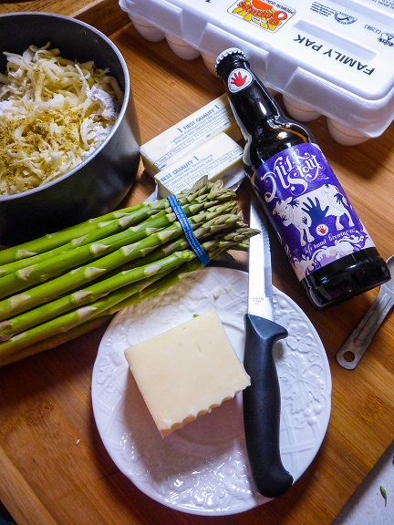 Captain Janeway's Dream Brunch: Coffee Stout Welsh Rarebit Benedict with Asparagus and Fresh Strawberries inspired by Star Trek: Voyager. Recipe by The Gluttonous Geek.