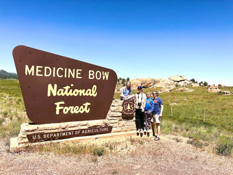 Medicine Bow sign family road trip