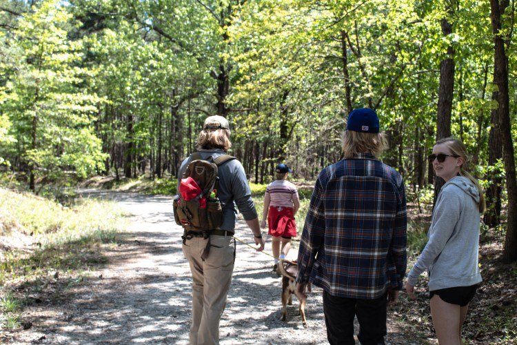 Family hiking with dog in a Wildlife Management Area