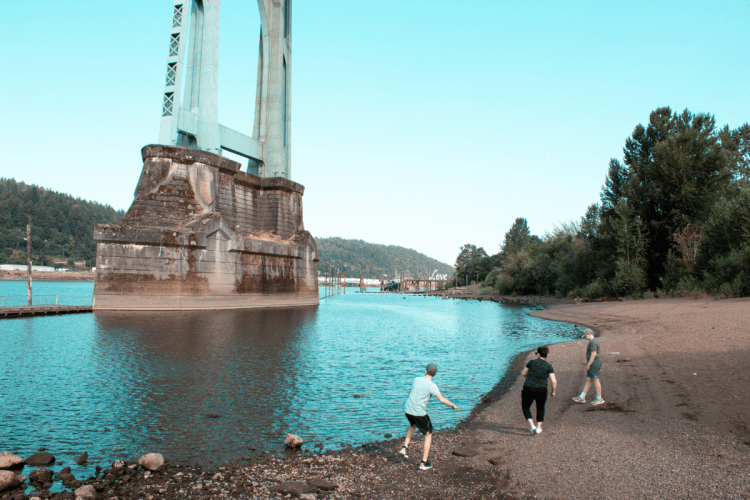 Playing on the riverfront at Cathedral Park in Portland Oregon