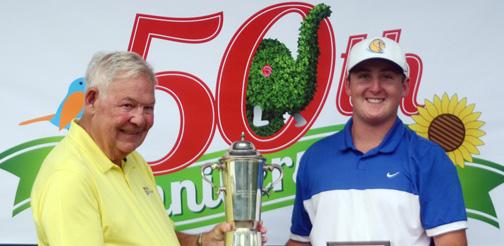 Festival of Flowers chairman Rupert Harley presents John Parker the winners trophy at the Festival golf tournament.