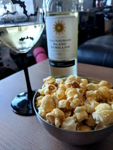 Bowl or Toffee Popcorn and glass of white wine