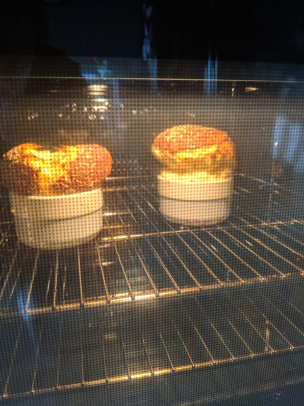 Two cheese souffle's in the oven