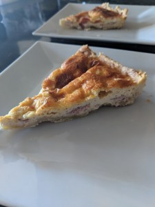 Quiche Lorraine on a white plate