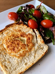 Egg in the hole with salad