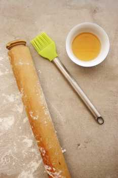 Rolling pin, pastry brush and heated honey