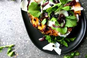 Baked squash with rocket and black garlic