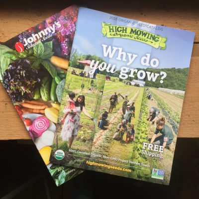 seed catalogs with open pollinated, heirloom, and hybrid seeds