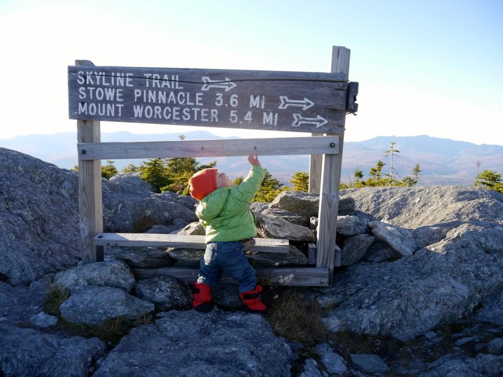 toddler on a mountain top