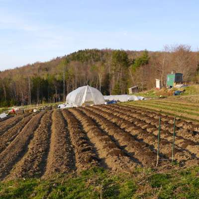 Preparing beds for planting on our organic farm; day jobs help us invest in growing the farm