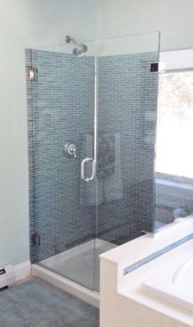 photo of glass tile shower and frameless shower doors