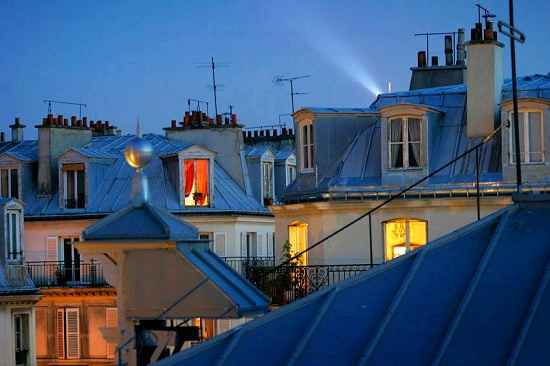 Paris rooftops night time