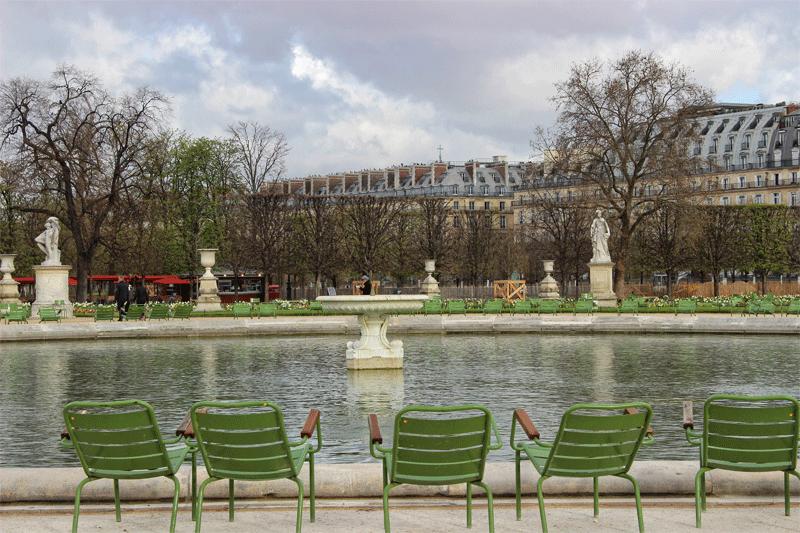 Green chairs around a pond in theTuileries Garden, Paris