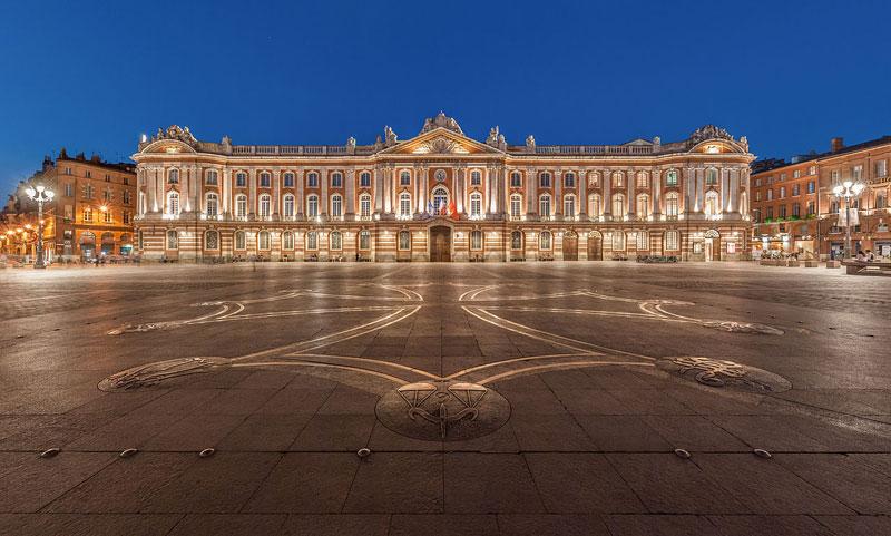 The vast square Place du Capitole, Toulouse at dusk