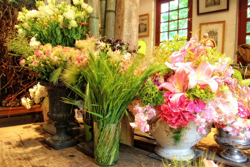 Huge bunches of flowers in jars in the floral studio at the Chateau de Chenonceau