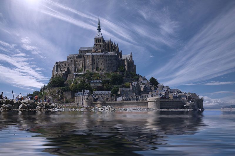 Mont Saint-Michel, a tiny island filled with medieval buildings and topped by an Abbey