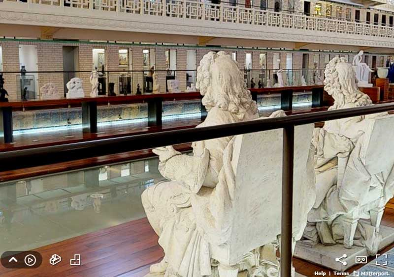 View of La Piscine swimming pool surrounded by statues and artworks seen through a virtual visit